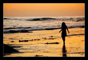Silhouette of girl on beach